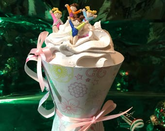 Girls cheer on faux cupcake