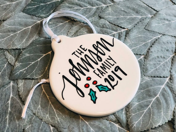 Personalized Family Christmas Ornament | 3.5 Inches Round Porcelain | Handpainted with Family Name, Holly, and 2019 | Stocking Stuffer