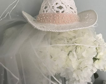 6ba3d6a2364c2 Hens bachelorettes blush and pearls Cowgirl hat   veil rustic bride to be  pre wedding shower party free bride 2 be badge future cowboy wifey
