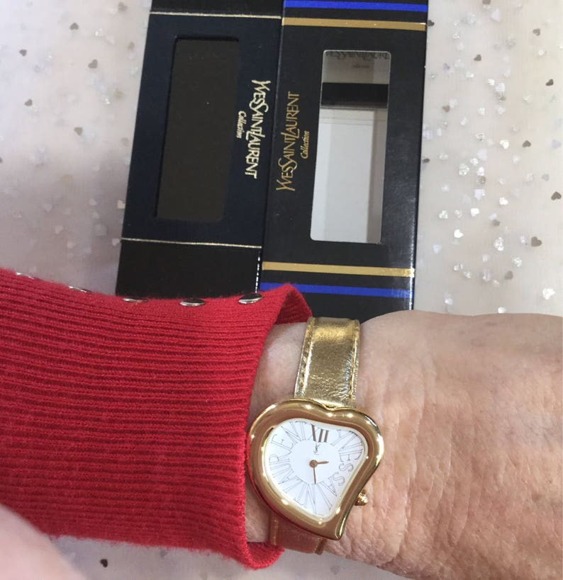 2a9b8e80e00 Authentic Yves Saint Laurent heart face gold tone watchserial image 0 ...