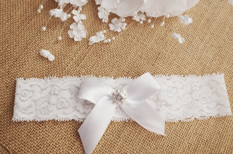 Wedding garter  ivory bridal garter ivory lace garter white bow garter rhinestone garter rhinestone bow lace garter toss garter lace garter