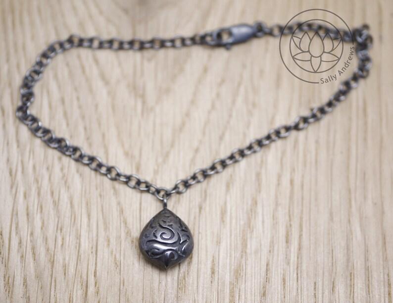 Handmade in Sterling silver elephant design. Ganesh Pod charm bracelet