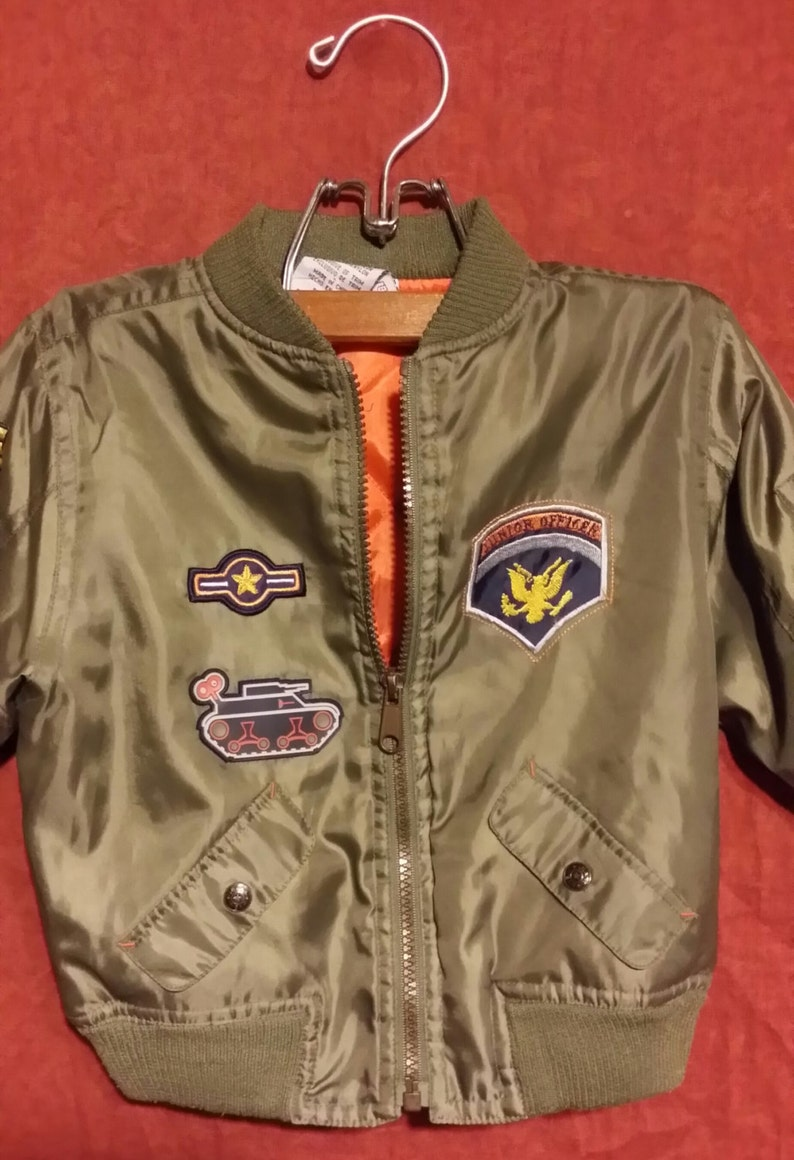 Little boy green vintage army jacket with decorative U.S front zip,100/% nylon army green with orange lining. metal and stripe decals