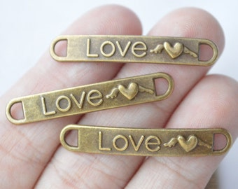 """100pcs bronze tone Small /""""Hand Made/"""" Charms 13x16mm"""