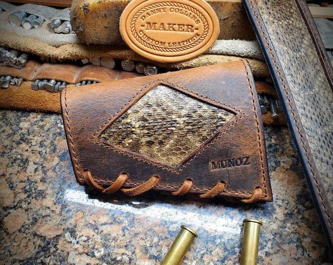 Buffalo buttstock ammo/cartridge sleeve with rattlesnake inlay.