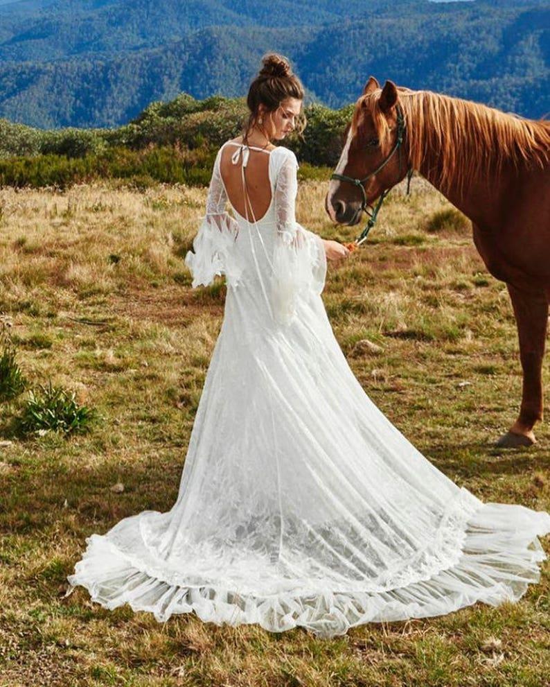 Image 0: White Lace Backless Wedding Dress At Reisefeber.org
