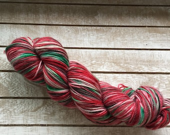 christmas sock yarn variegated in red and green with contrasting green toes merino super wash hand dyed christmas sock yarn