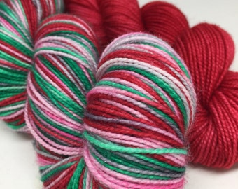 Hand dyed Christmas sock yarn perfect for your Christmas socks, hand dyed Christmas sock yarn on sparkle base with heels and toes in red soc