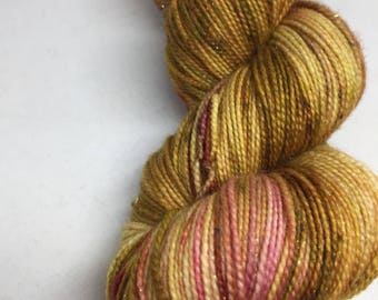 Hand dyed yarn in carmel yellows and browns with a hint of red popping through here and there   Indied dyed yarn dyed in the Arizona sun