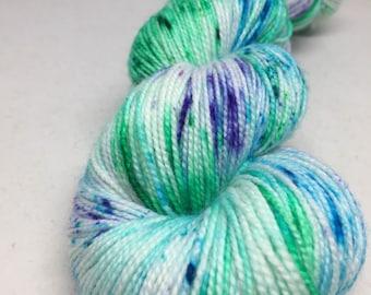 Hand dyed sock yarn in blues, greens and purples, indie dyed superwash merino sock yarn