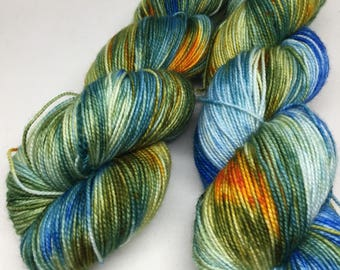 Sock weight hand dyed yarn in  blues and oranges perfect for  knitting and crocheting, Indie dyed aqua sports weight superwash for shawls