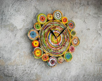 Rainbow round hand made paper wall clock no ticking designer clocks. Multicolored wall handmade clock from newspapers pipes.