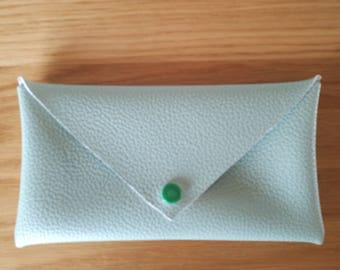 Green faux leather clutch