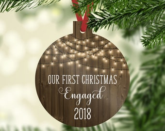 our first christmas engaged 2018 ornament faux wood background farmhouse white christmas lights rustic christmas ornaments 2018 ornament - Rustic Christmas Ornaments