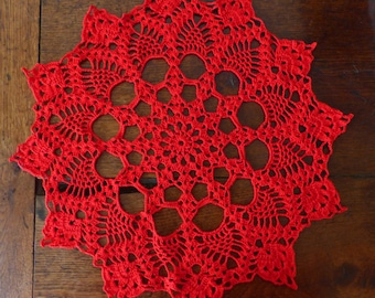 Red round crochet doily