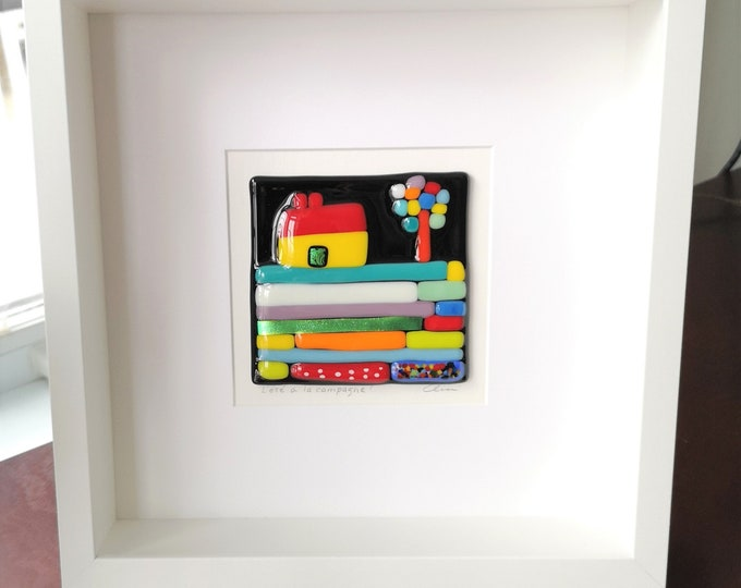 Square white frame made of wood and multicolored merged glass, Summer in the countryside