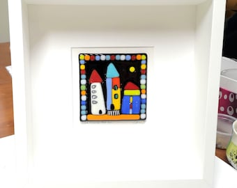 Square white wooden frame and multicolored fused glass, wall decoration, it leans over here