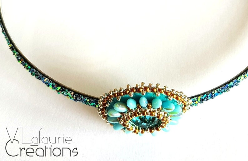 Metallic sequined headband and blue flower embroidered on Miyuki beaded leather