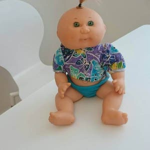Rare pool bath Cabbage patch kids doll and water buggy car bike Very good condition bath wind up and go seals a squirter Collectable doll