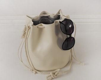 Vegan white leather drawstring bucket bag with cotton rope