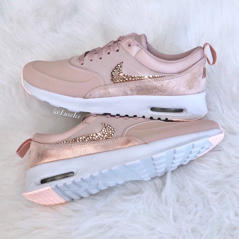Swarovski Nike Air Max Thea Premium Particle BeigeSummit WhiteCrimson Tint Blinged with SWAROVSKI® Xirius Rose Cut Crystals.