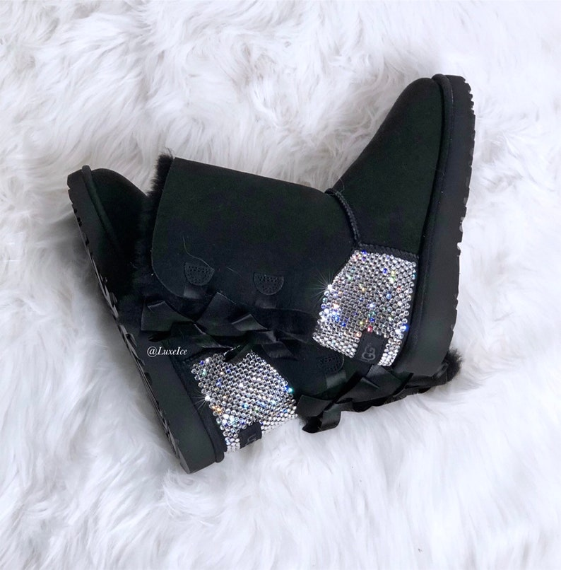 7a2116de90b Swarovski Ugg Boots Bailey Bow - Black customized with SWAROVSKI® Xirius  Rose-Cut Crystals.