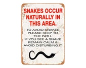 Snakes Occur Naturally in This Area Vintage Look Metal Sign