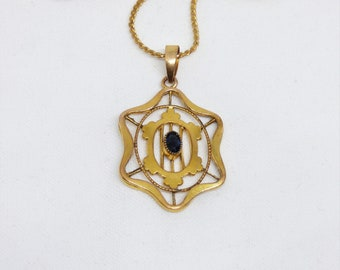 Excellent Quality Antique Edwardian Gold Filled Openwork Pendant Set With A Paste Blue Sapphire By Kollmar & Jourdan Of Germany Circa 1900