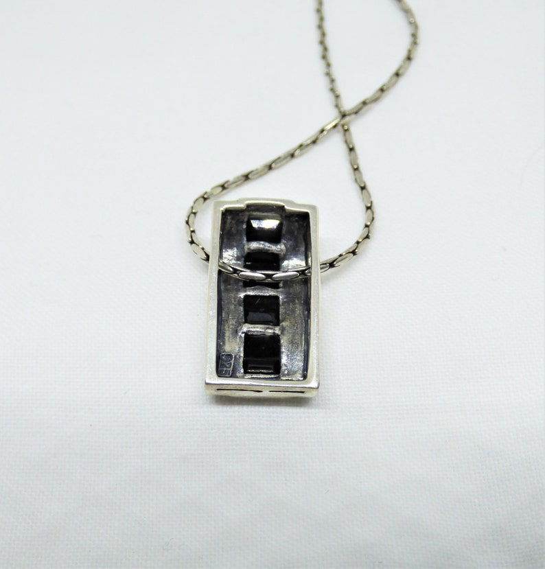 Vintage Solid Silver Curved Oblong Shaped Pendant With 7 Black Baguette Down The Centre Flanked By Black Enamel Art Deco Revival C1970-1980s