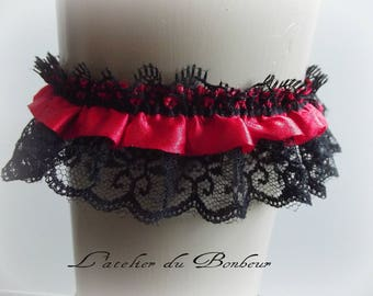 Red and black satin and lace garter
