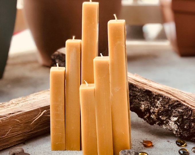 """This set of 3 unique square 100% pure beeswax pillar candles. Rustic and modern organic pure beeswax candle set. 1"""" wide and up to 9"""" tall."""
