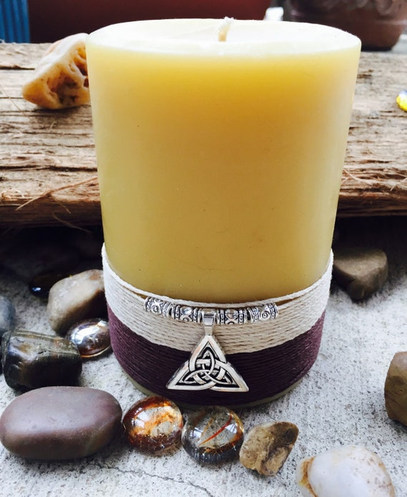 100% Pure Beeswax Pillar candle wrapped w/all natual hemp cord and affixe with a  Celtic Knot charm