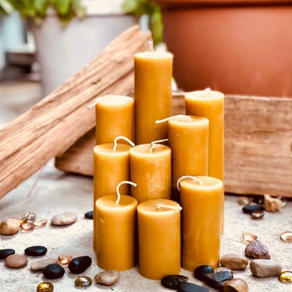 "100% Pure Beeswax Pillar candles. 2"" in diameter and up to 8"" tall Natural Honey, Heilala Vanilla, Ceylon Cinnamon or lemon scented"