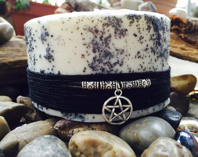 Black Salt Spell Candle. Unscented and charmed with a Pentacle.