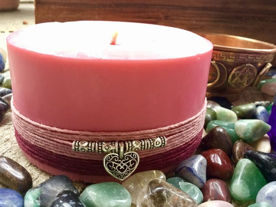 Love Spell Candle made w/soy and apple scented. Embedded w/rose quartz and wrapped w/a heart charm