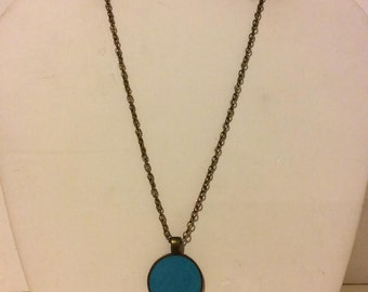 Turquoise and bronze round resin pendant necklace