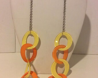 Long yellow and orange chunky resin link necklace