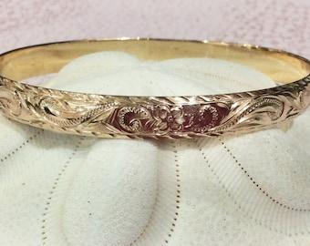 14 karat , 8mm Hawaiian bangle, plumeria princess design.