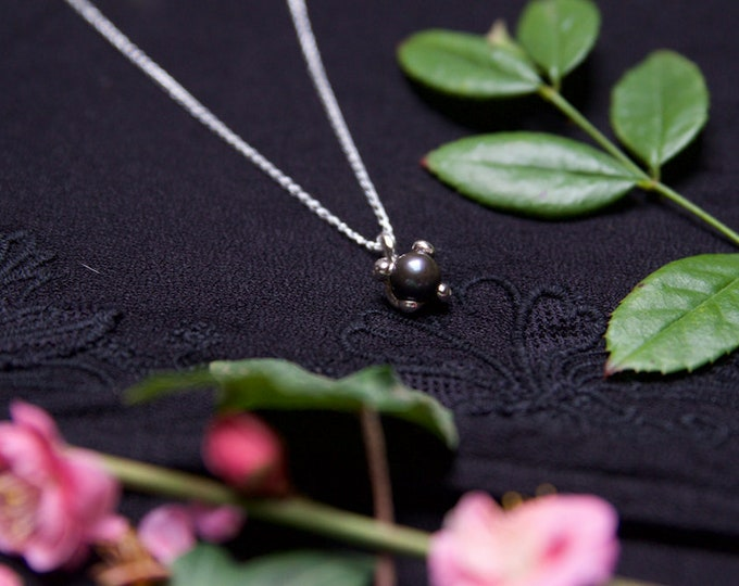Black Pearl set in Drippy Sterling Silver.