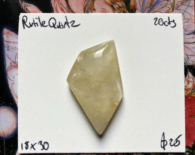 Freeform faceted rutile quartz cabochon