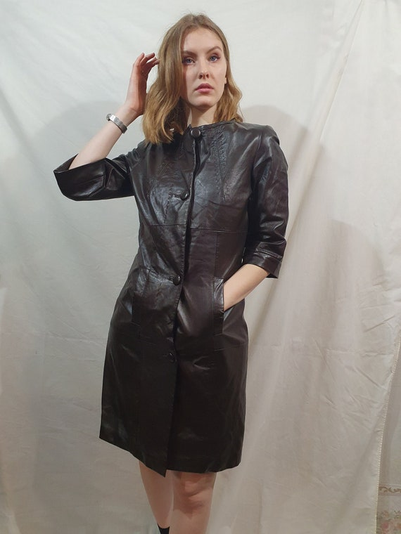 Delicate dress made of black genuine leather. Styl