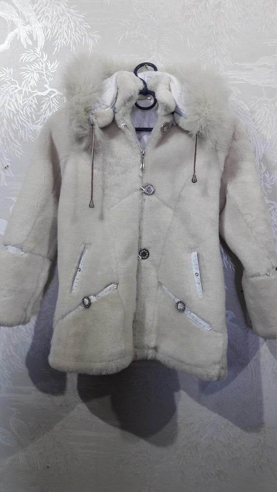 Cute children's sheepskin coat. Beige children's s