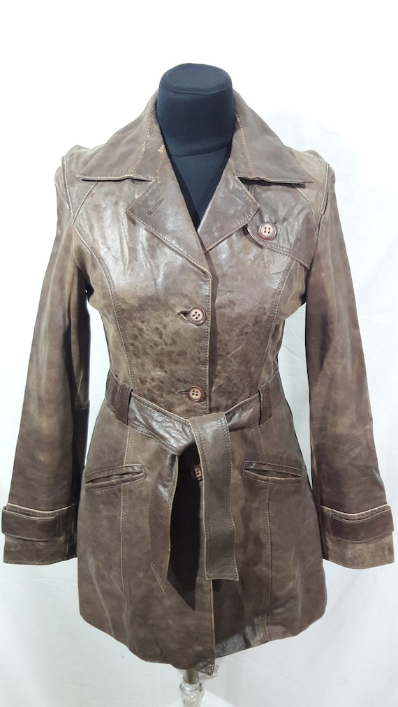A simple long jacket. Women's jacket made of genui