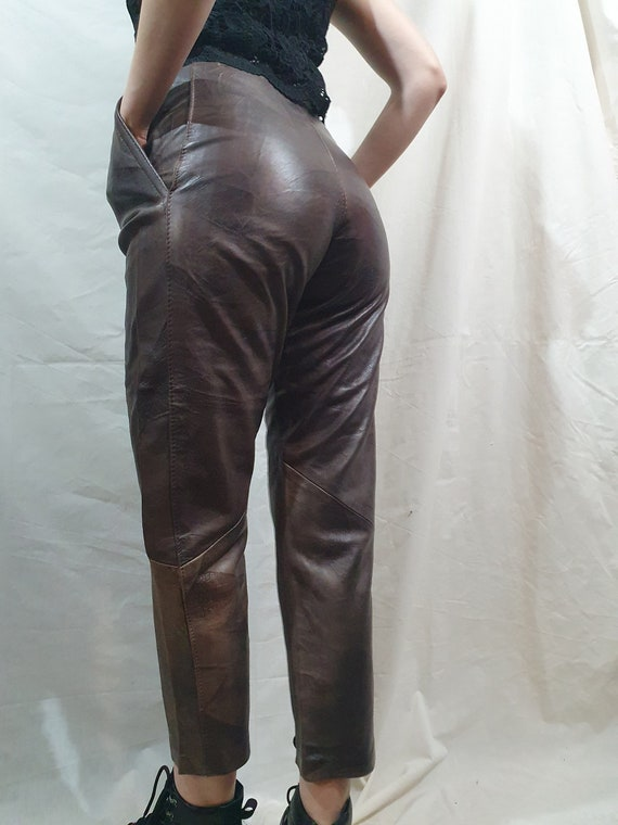 Simple women's genuine leather pants. Light brown