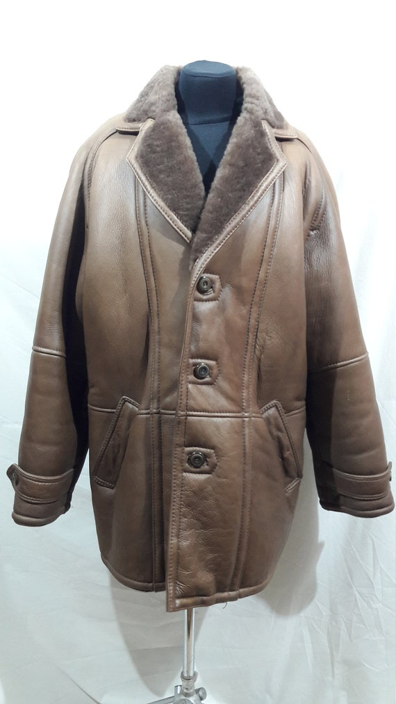 Warm reliable men's sheepskin coat made of natural