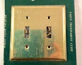 Vintage 70 39 s brass double light switch plate cover. Old stock. New in package. Lawuered brass switch plate cover. Made in Canada.