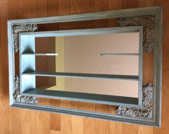 Unique antique mirrored shelf. Large ornate shelving with mirrored background. Rare painted and distressed antique shelving unit with mirror