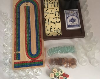 Vintage lot of game pieces. Destash lot of game pieces. Clear and frosted glass chess pieces. Cribbage board. Dice lot.