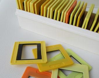 Vintage slide frame set of 36 in original plastic box, orange, yellow and black colour, Soviet diapositive photo frames, made in USSR