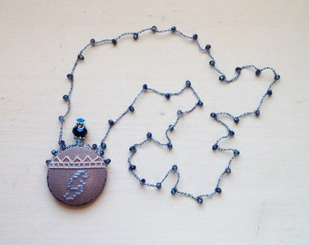 Hand-embroidered necklace with letter G